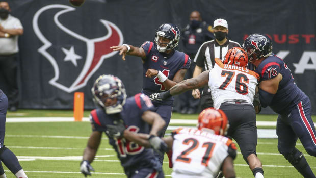 Dec 27, 2020; Houston, Texas, USA; Houston Texans quarterback Deshaun Watson (4) throws a pass against the Cincinnati Bengals during the first quarter at NRG Stadium. Mandatory Credit: Troy Taormina-USA TODAY Sports