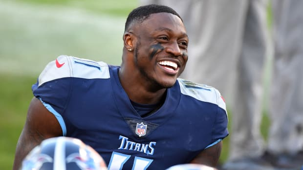 Titans receiver A.J. Brown smiling on the sideline