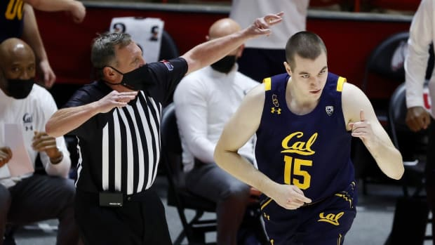 Grant Anticevich celebrates a basket against Utah