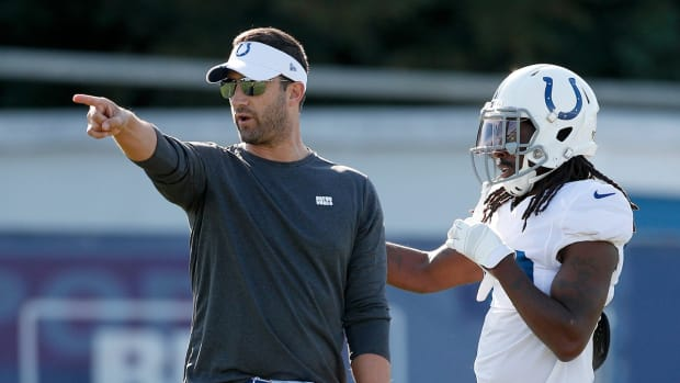 Indianapolis Colts offensive coordinator Nick Sirianni works with wide receiver T.Y. Hilton (13) during their preseason training camp practice at Grand Park in Westfield on Sunday, August 11, 2019. Colts Preseason Training Camp