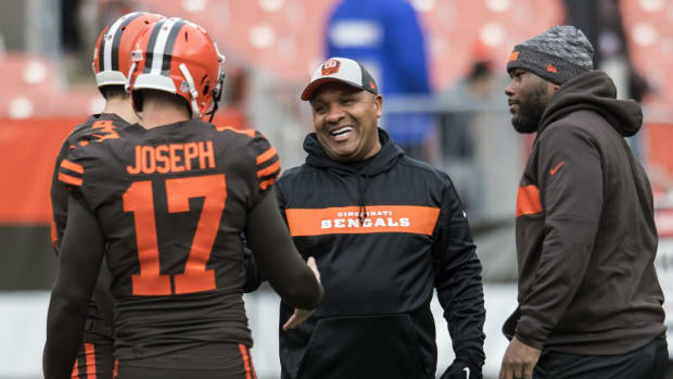 Dec 23, 2018; Cleveland, OH, USA; Former Cleveland Browns head coach and current Cincinnati Bengals special assistant to the head coach Hue Jackson (center) talks with Cleveland Browns kicker Greg Joseph (17) and punter Britton Colquitt (4) before the game between the Cleveland Browns and the Cincinnati Bengals at FirstEnergy Stadium. Mandatory Credit: Ken Blaze-USA TODAY Sports