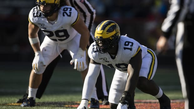 Nov 2, 2019; College Park, MD, USA; Michigan Wolverines defensive lineman Kwity Paye (19) and linebacker Jordan Glasgow (29) prior to the snap during the \2g\ against the Maryland Terrapins at Capital One Field at Maryland Stadium.