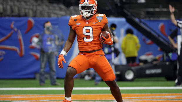 Jan 1, 2021; New Orleans, LA, USA; Clemson Tigers running back Travis Etienne (9) scores a touchdown against the Ohio State Buckeyes during the first half at Mercedes-Benz Superdome.