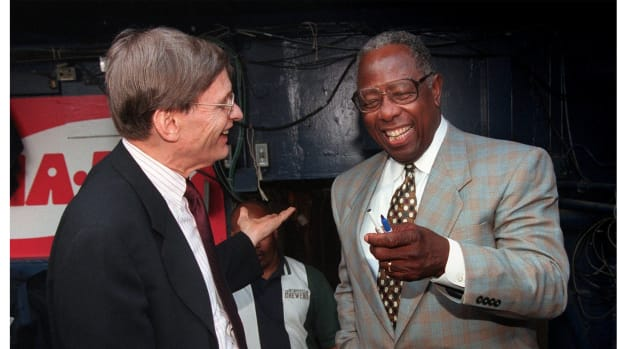 Bud Selig chats with Hank Aaron before the Brewers game against the White Sox at Milwaukee County Stadium, Tuesday, July 20, 1999.