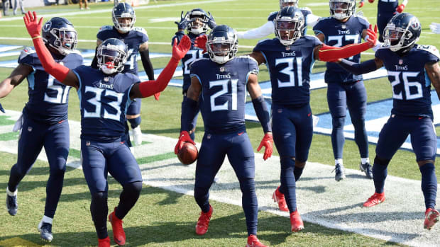 Tennessee Titans cornerback Malcolm Butler (21) and the team celebrate his interception in the first quarter during the Tennessee Titans game against the Baltimore Ravens in Nashville on January 10, 2021.