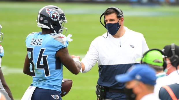 Tennessee Titans wide receiver Corey Davis (84) is congratulated by Tennessee Titans head coach Mike Vrabel after a touchdown during the first half against the Pittsburgh Steelers at Nissan Stadium.