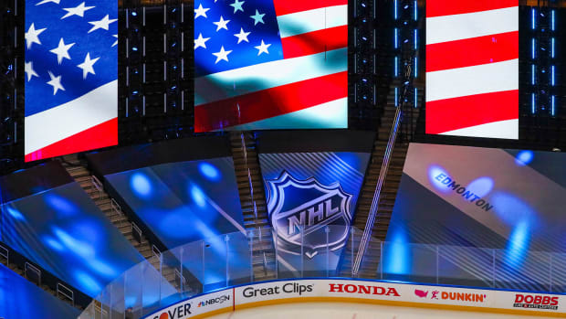 Aug 12, 2020; Edmonton, Alberta, CAN; General view of American flag and NHL logo prior to the game between the St. Louis Blues and the Vancouver Canucks in game one of the first round of the 2020 Stanley Cup Playoffs at Rogers Place.
