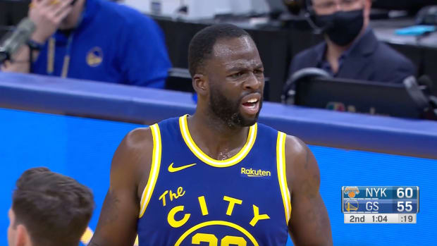 Draymond Green reacts after being ejected