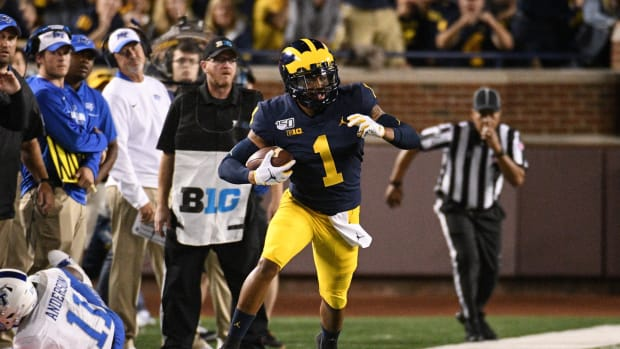 Aug 31, 2019; Ann Arbor, MI, USA; Michigan Wolverines defensive back Ambry Thomas (1) runs an interception back during the game against the Middle Tennessee Blue Raiders at Michigan Stadium.