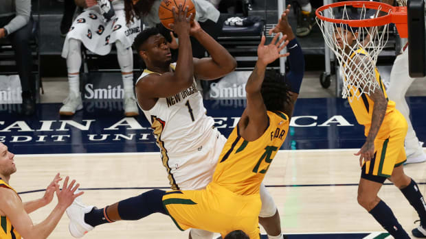 Jan 19, 2021; Salt Lake City, Utah, USA; New Orleans Pelicans forward Zion Williamson (1) shoots the ball over Utah Jazz center Derrick Favors (15) during the first quarter at Vivint Smart Home Arena. Mandatory Credit: Chris Nicoll-USA TODAY Sports