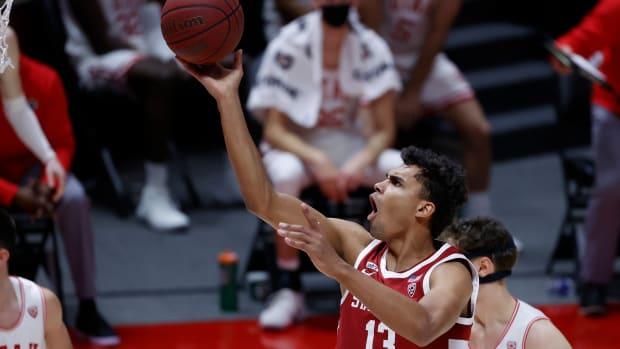 Stanford Cardinal forward Oscar da Silva (13) drives to the hoop past Utah Utes forward Mikael Jantunen (20) in the first half at Jon M. Huntsman Center.