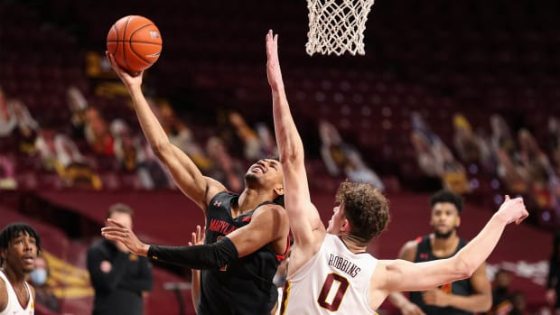 Jan 23, 2021; Minneapolis, Minnesota, USA; Maryland Terrapins guard Aaron Wiggins (2) shoots the ball as Minnesota Gophers center Liam Robbins (0) guards him during the first half at Williams Arena.