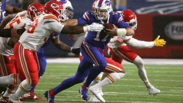 Josh Allen runs from Kansas City defenders during the Chiefs' 26-17 win against the Buffalo Bills at Bills Stadium on Oct. 19, 2020. Jg 101920 Bills 5 © Jamie Germano/Rochester Democrat and Chronicle via Imagn Content Services, LLC