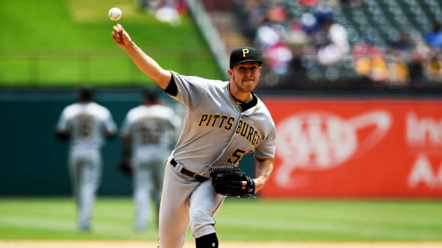 May 1, 2019; Arlington, TX, USA; Pittsburgh Pirates starting pitcher Jameson Taillon (50) delivers a warm-up pitch during the second inning against the Texas Rangers at Globe Life Park in Arlington.