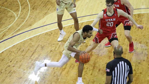 Jamal Bey drives to the basket against Utah.