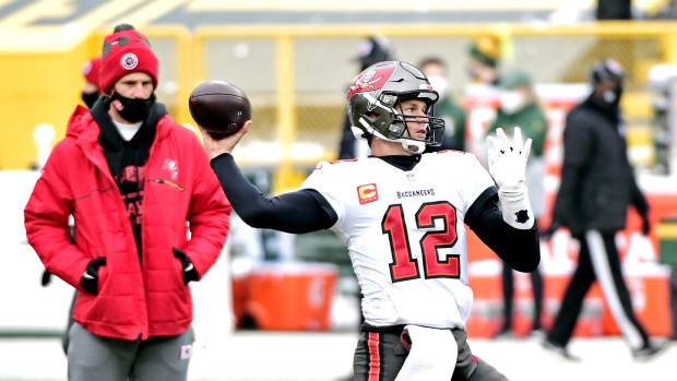 Jan 24, 2021; Green Bay, Wisconsin, USA; Tampa Bay Buccaneers quarterback Tom Brady (12) warms up before playing the Green Bay Packers in the NFC Championship Game at Lambeau Field . Mandatory Credit: Benny Sieu-USA TODAY Sports