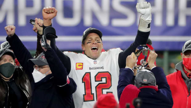 Tampa Bay Buccaneers quarterback Tom Brady (12) exalts during the presentation off the George Halas Trophy after their NFC Championship game Sunday, January 24, 2021 at Lambeau Field in Green Bay