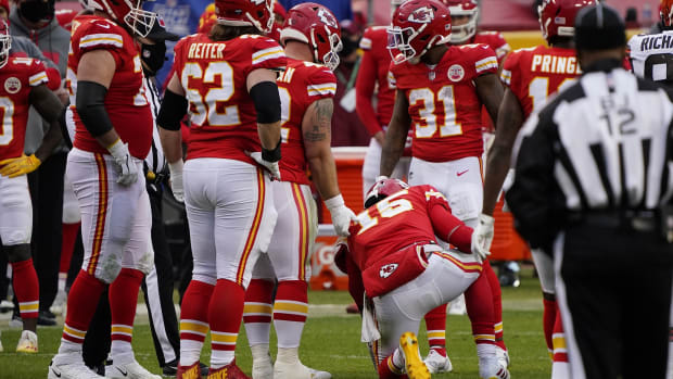Jan 17, 2021; Kansas City, Missouri, USA; Kansas City Chiefs quarterback Patrick Mahomes (15) is slow getting up after being brought down by Cleveland Browns outside linebacker Mack Wilson (51) during the second half in the AFC Divisional Round playoff game at Arrowhead Stadium. Mahomes would be taken out for the remainder of the game.