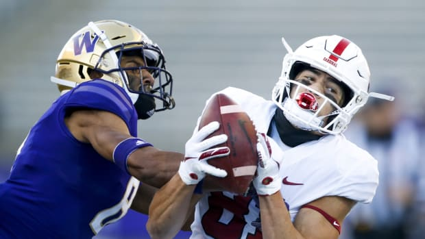 Dec 5, 2020; Seattle, Washington, USA; Stanford Cardinal wide receiver Brycen Tremayne (81) catches a pass against Washington Huskies defensive back Keith Taylor (8) during the third quarter at Alaska Airlines Field at Husky Stadium.