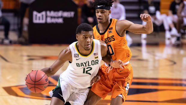Baylor's Jared Butler dribbles against Oklahoma State