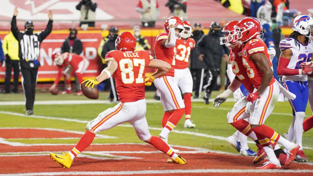 Jan 24, 2021; Kansas City, MO, USA; Kansas City Chiefs tight end Travis Kelce (87) celebrates after scoring a touchdown against the Buffalo Bills during the third quarter in the AFC Championship Game at Arrowhead Stadium. Mandatory Credit: Denny Medley-USA TODAY Sports