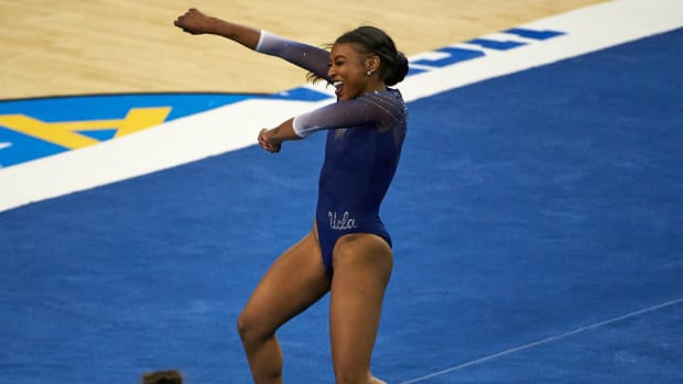 UCLA gymnast Nia Dennis performs her floor routine in Saturday's meet against Arizona State
