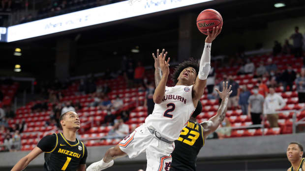 Jan 26, 2021; Auburn, Alabama, USA; Auburn Tigers guard Sharife Cooper (2) shoots against the Missouri Tigers during the first half at Auburn Arena.