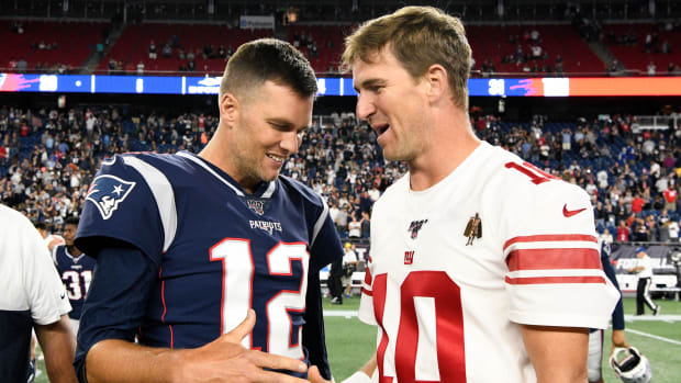 Tom Brady greets Eli Manning after preseason game