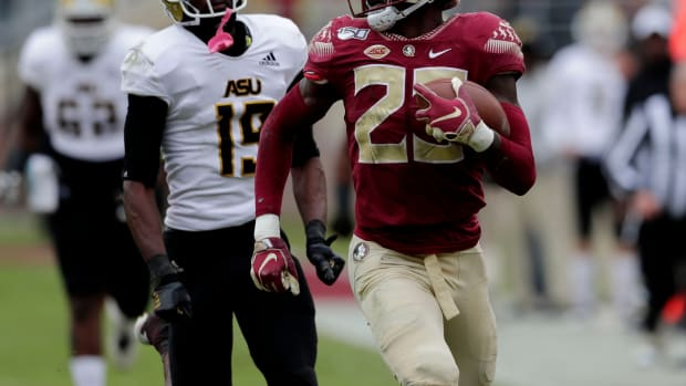 Florida State defensive back Hamsah Nasirildeen (23) looks over his shoulder as he scores a touchdown. The Florida State Seminoles beat the Alabama State Hornets, 49-12, on Saturday, Nov. 16, 2019.