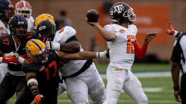 Kellen Mond throws a pass during the Senior Bowl