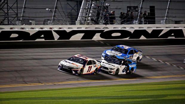 Feb 17, 2020; Daytona Beach, Florida, USA; NASCAR Cup Series driver Denny Hamlin (11) and NASCAR Cup Series driver Ryan Newman (6) during the Daytona 500 at Daytona International Speedway.