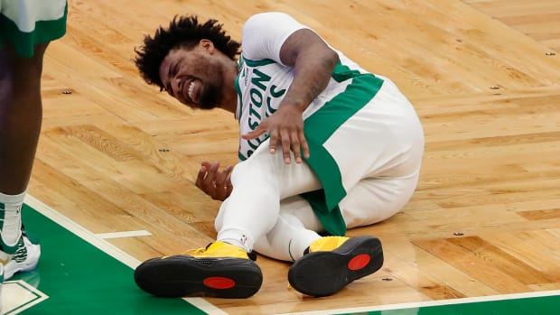 Marcus Smart suffers a left calf injury against the Los Angeles Lakers on Jan. 30, 2021.
