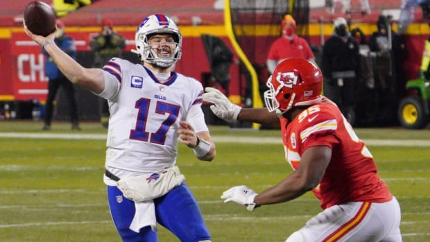 Bills quarterback Josh Allen (17) is pressured by Kansas City Chiefs defensive tackle Chris Jones (95) during the third quarter of the AFC Championship Game at Arrowhead Stadium.