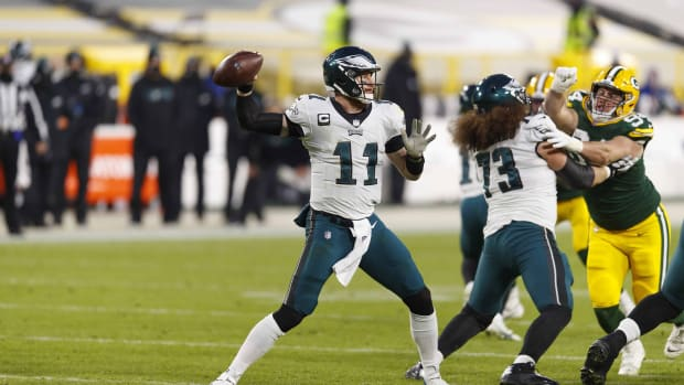 Dec 6, 2020; Green Bay, Wisconsin, USA; Philadelphia Eagles quarterback Carson Wentz (11) throws a pass during the second quarter against the Green Bay Packers at Lambeau Field. Mandatory Credit: Jeff Hanisch-USA TODAY Sports