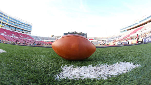 A football sits on the field at Texas Tech's stadium