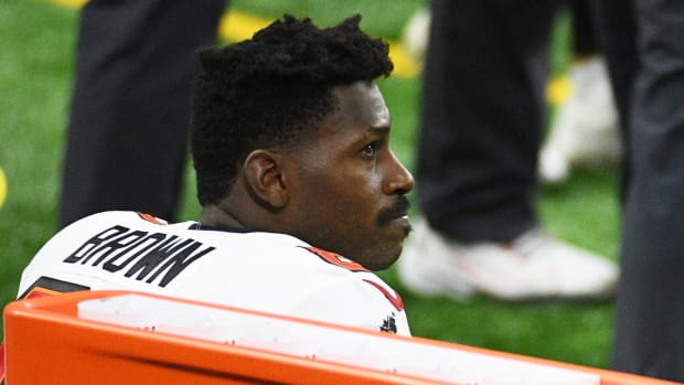 Bucs receiver Antonio Brown sits on the bench during a game against the Lions