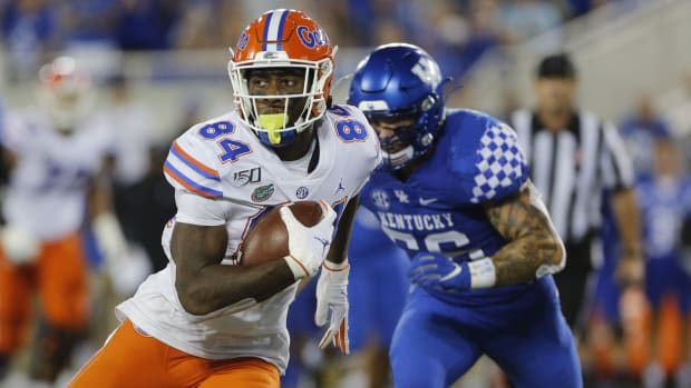Sep 14, 2019; Lexington, KY, USA; Florida Gators tight end Kyle Pitts (84) runs the ball against the Kentucky Wildcats linebacker Kash Daniel (56) in the 4th quarter at Kroger Field. Mandatory Credit: Mark Zerof-USA TODAY Sports