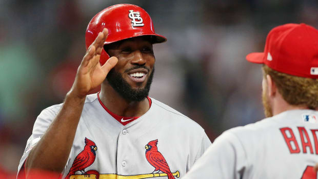 Cardinals outfielder Dexter Fowler celebrates after scoring a run against the Braves.
