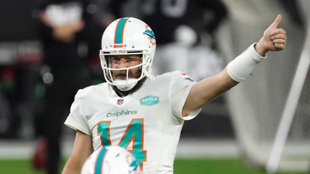 Miami Dolphins quarterback Ryan Fitzpatrick gestures in the fourth quarter against the Las Vegas Raiders at Allegiant Stadium.