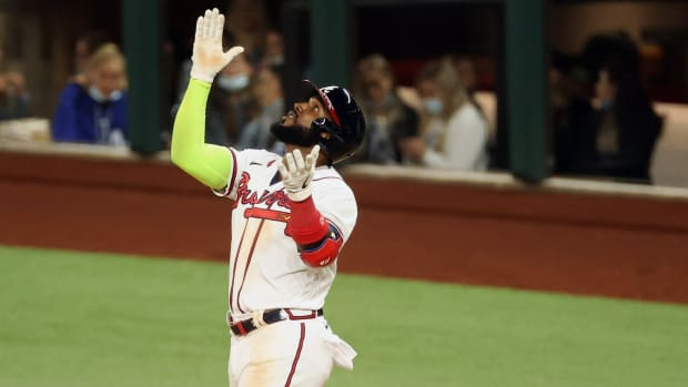Marcell Ozuna celebrates after driving in a run against the Dodgers in the 2020 NLCS.