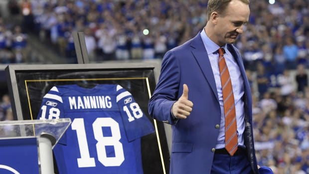 Peyton Manning gives a thumbs up after being inducted into the Indianapolis Colts Ring of Honor in 2017.