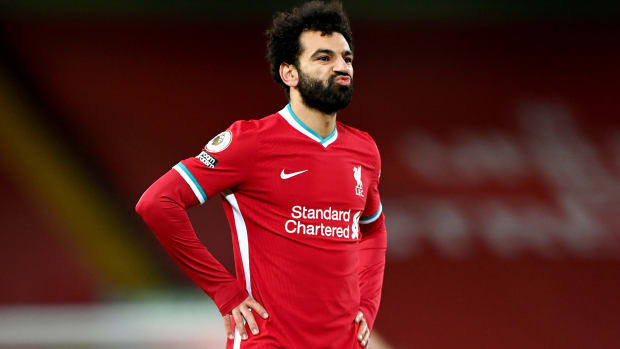 LIVERPOOL, ENGLAND - FEBRUARY 07: Mohamed Salah of Liverpool reacts during the Premier League match between Liverpool and Manchester City at Anfield on February 07, 2021 in Liverpool, England. Sporting stadiums around the UK remain under strict restrictions due to the Coronavirus Pandemic as Government social distancing laws prohibit fans inside venues resulting in games being played behind closed doors.
