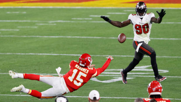 Patrick Mahomes throws an acrobatic incomplete pass in Super Bowl LV.