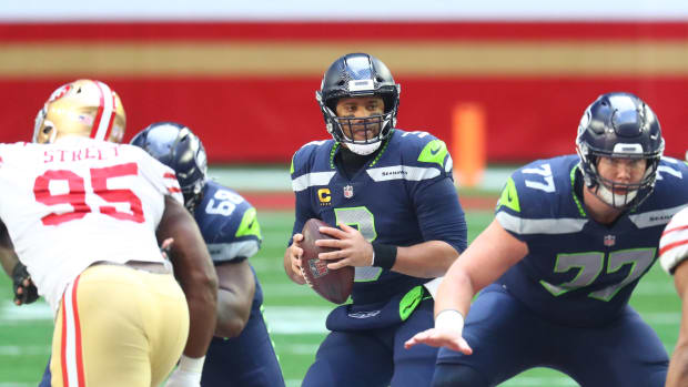 Seattle Seahawks quarterback Russell Wilson (3) drops back to pass against the San Francisco 49ers during the first half at State Farm Stadium.