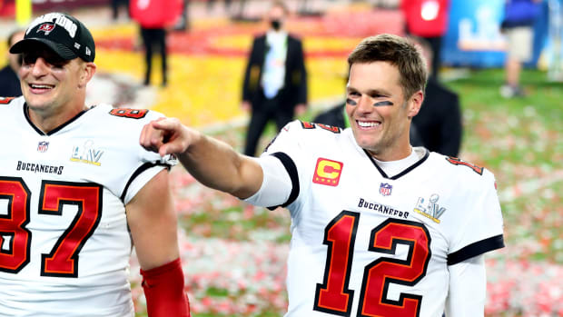 Feb 7, 2021; Tampa, FL, USA; Tampa Bay Buccaneers quarterback Tom Brady (12) and tight end Rob Gronkowski (87) celebrate after beating the Kansas City Chiefs in Super Bowl LV at Raymond James Stadium. Mandatory Credit: Mark J. Rebilas-USA TODAY Sports