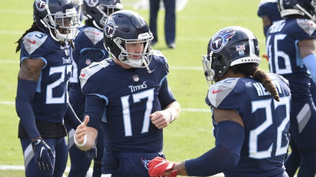 Tennessee Titans quarterback Ryan Tannehill (17) greets Tennessee Titans running back Derrick Henry (22) prior to their AFC Wild Card game against the Baltimore Ravens.