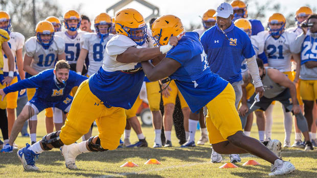 McNeese football players tackle during a spring practice