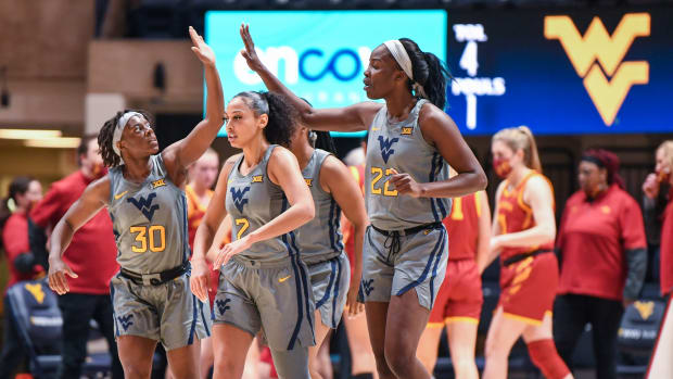 West Virginia guards Madisen Smith (30) and Kysre Gondrezick (2) and Center Blessing Ejiofer (22).