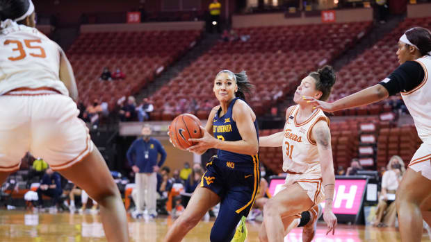 West Virginia guard Kysre Gondrezick goes for a game-high 24 points in the Mountaineers 92-58 win over Texas on February on January 9th.