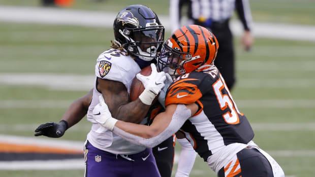 Jan 3, 2021; Cincinnati, Ohio, USA; Baltimore Ravens running back Gus Edwards (35) tackled by Cincinnati Bengals linebacker Markus Bailey (51) during the second half at Paul Brown Stadium. Mandatory Credit: Joseph Maiorana-USA TODAY Sports